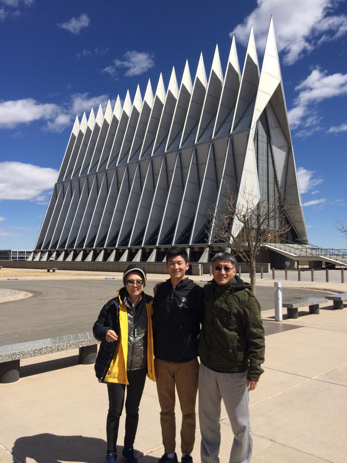 John Kim and his parents stands outside the Cadet Chapel at USAFA. Although Kim is committed to West Point, he visited the United States Air Force Academy over spring break this year.  Photo courtesy of John Kim