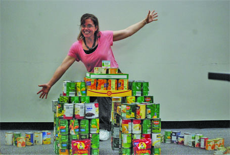 French teacher Lori Turnage poses with her cans during Canstruction. Turnages class won the food drive competition this year.