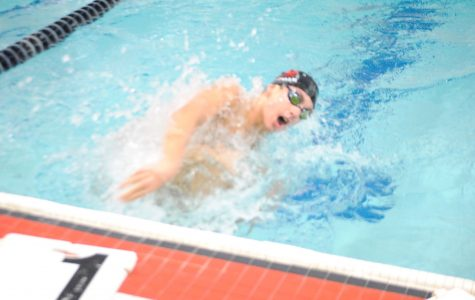 Boys swimming edges Parkway West in close dual