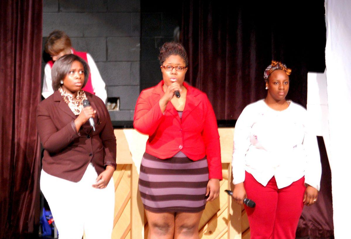 Eboni Johnson, Janese Johnson and Jennifer Wade sing