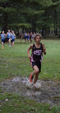 Splashing through the puddles on his way to earn first place at the conference meet, sophomore Charlie McIntyre helps the team earn 2nd place at the the meet which was held on Oct. 11 at Willmore Park.
