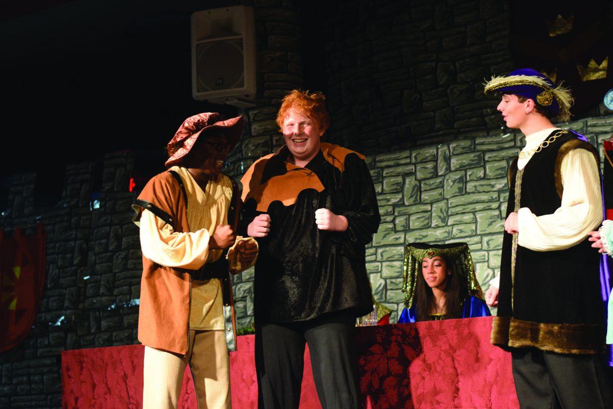 Junior Will Harold and senior Ben Scissors playing Italian insurance salesmen in the Madrigal performance on Dec. 11
