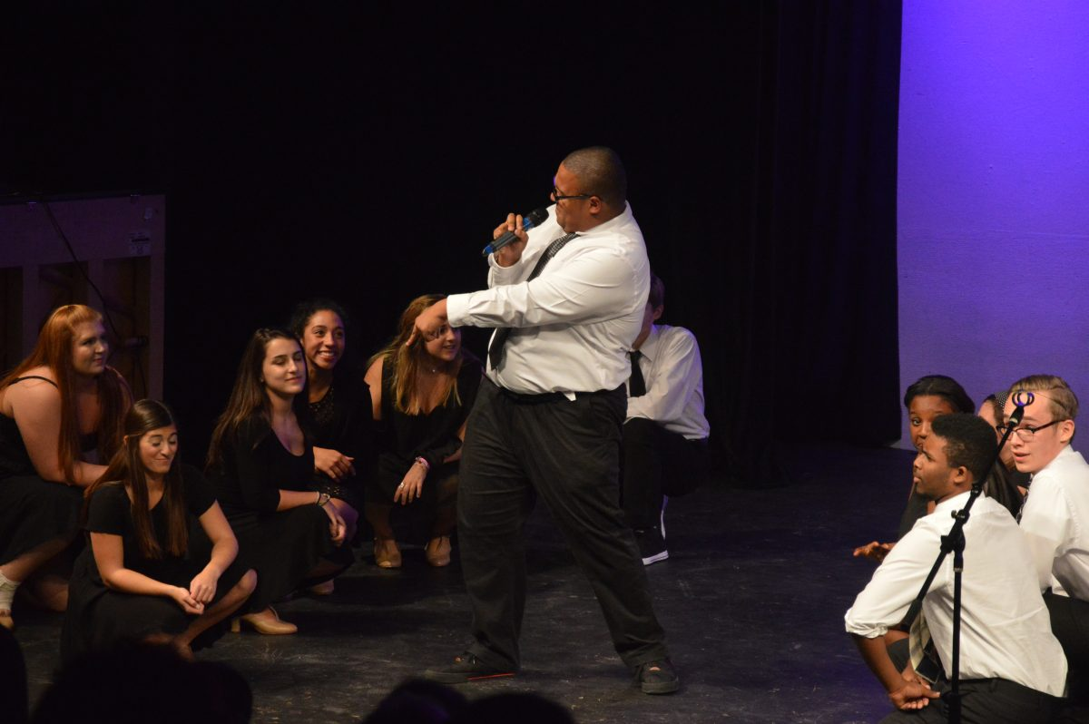 Junior Anthony Blatter sings his solo to the Disney song Dig a little Deeper on Oct.16.