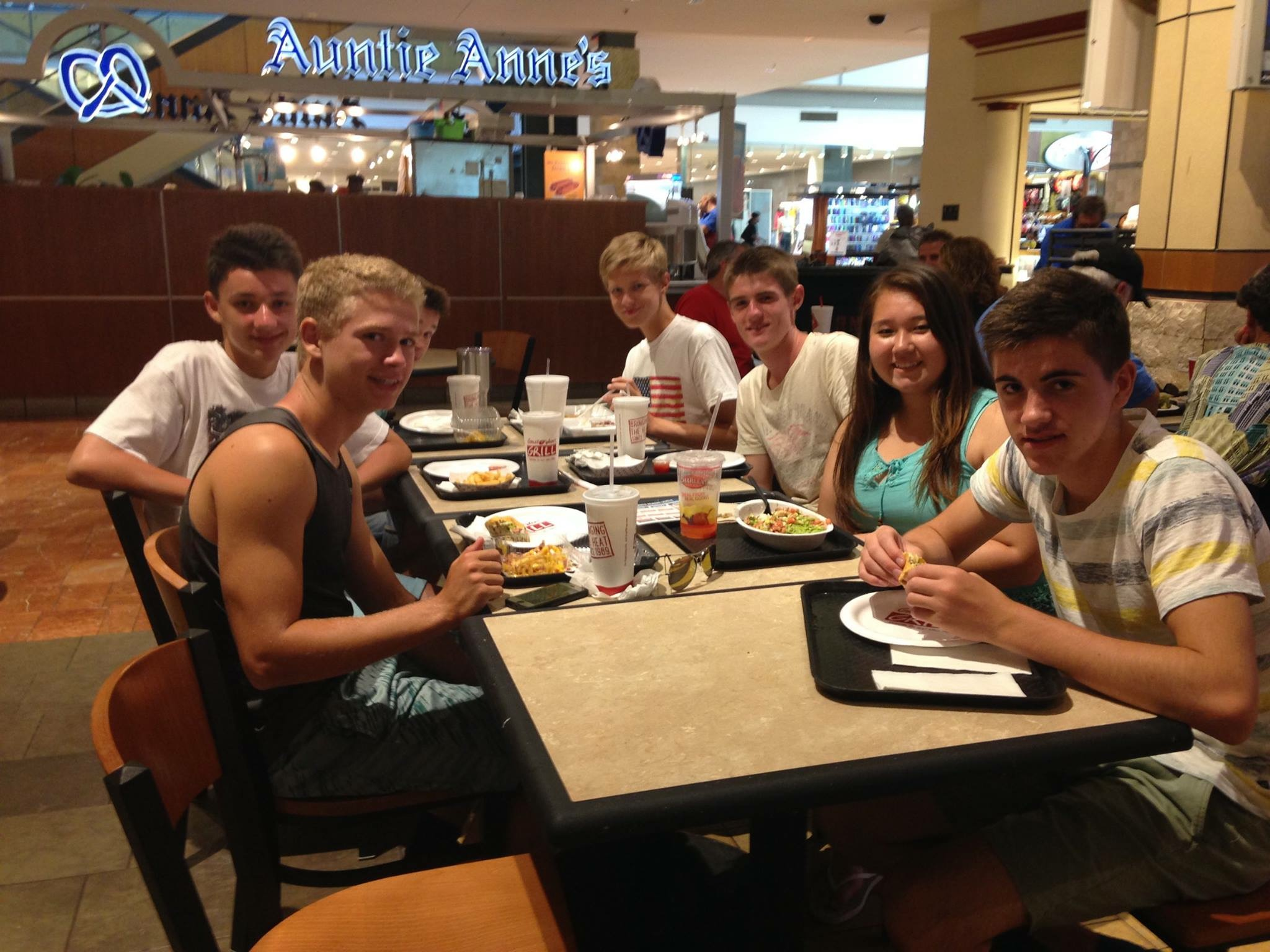 Exchange students Nicolas Gorres, Moritz Dittrich and Kai  Borgen enjoy lunch time with host brother and sister, Patricia Rutherford and Spencer Hritz. Photo courtesy of Patricia Rutherford.