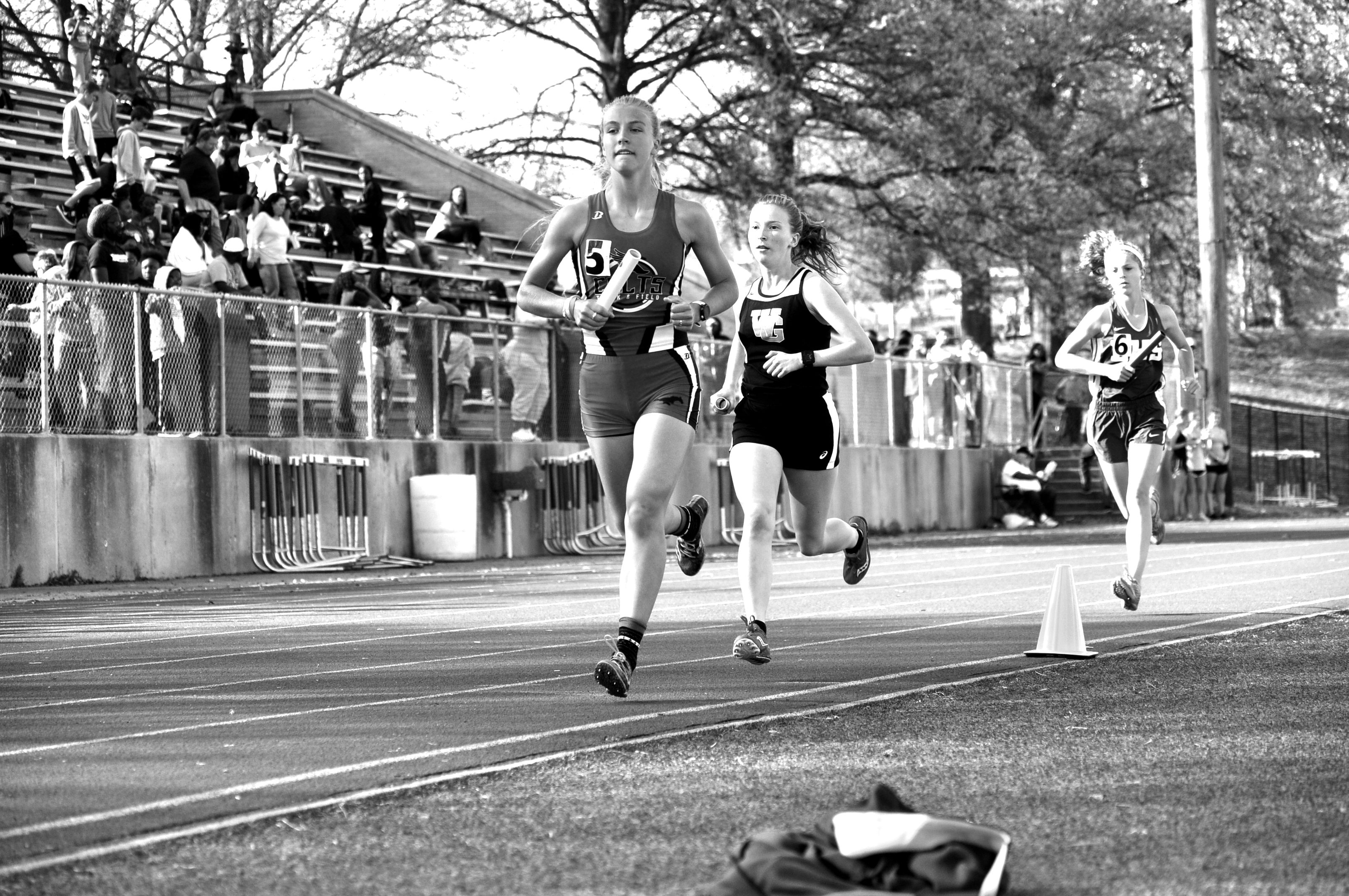 Senior Richelle Bain finishes her leg of the varsity 4x800-meter relay at the Henle Holmes meet at home on April 12. Photo by Madeline Lee
