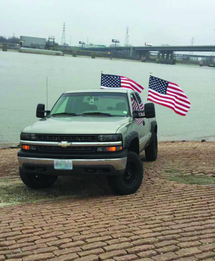 Senior Ryan Geisz's truck beside the Missouri river.