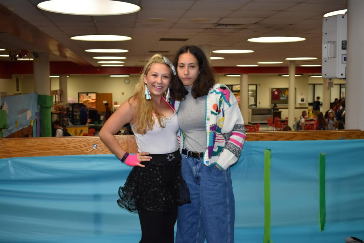 Juniors Mariah Sindel and Sandy Chasnoff pose in their Way back Wednesday outfits as a part of Homecoming Week.