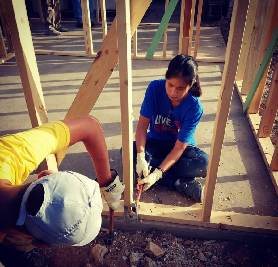 Tian Strege and fellow mission trip group member, working on building the home for a person in need living in Acuna, Mexico. Photo courtesy of Tian Stege.