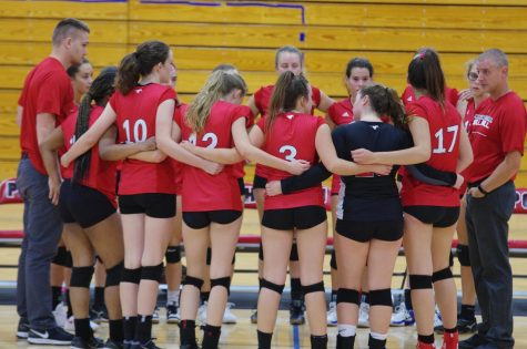 "Head Coach Tom Schaefer directs his team against John Burroughs on Sept. 5. They eventually took the game 2-1. ""The season was challenging, but rewarding,"" Schaefer said.  ""It was challenging yet really fun and overall a great experience,"" Julia Hendricks (12) said."