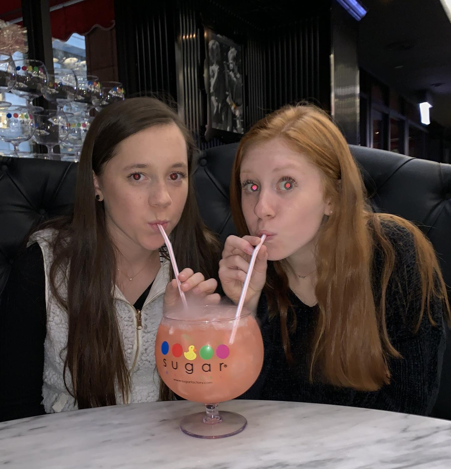 PCH Publications staff member sophomores, Sydney Stahlschmidt and Sydney Kolker, drinking The Watermelon Patch drink at The Sugar Factory during the journalism convention in Chicago.