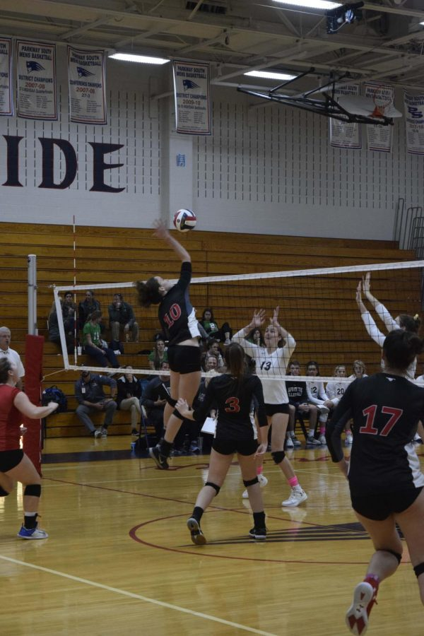 Senior Mackenzie Duvall attempts to kill the ball against Lafayette in ditricts. Lafayette took the victory in two sets, eventually advancing on to state.
