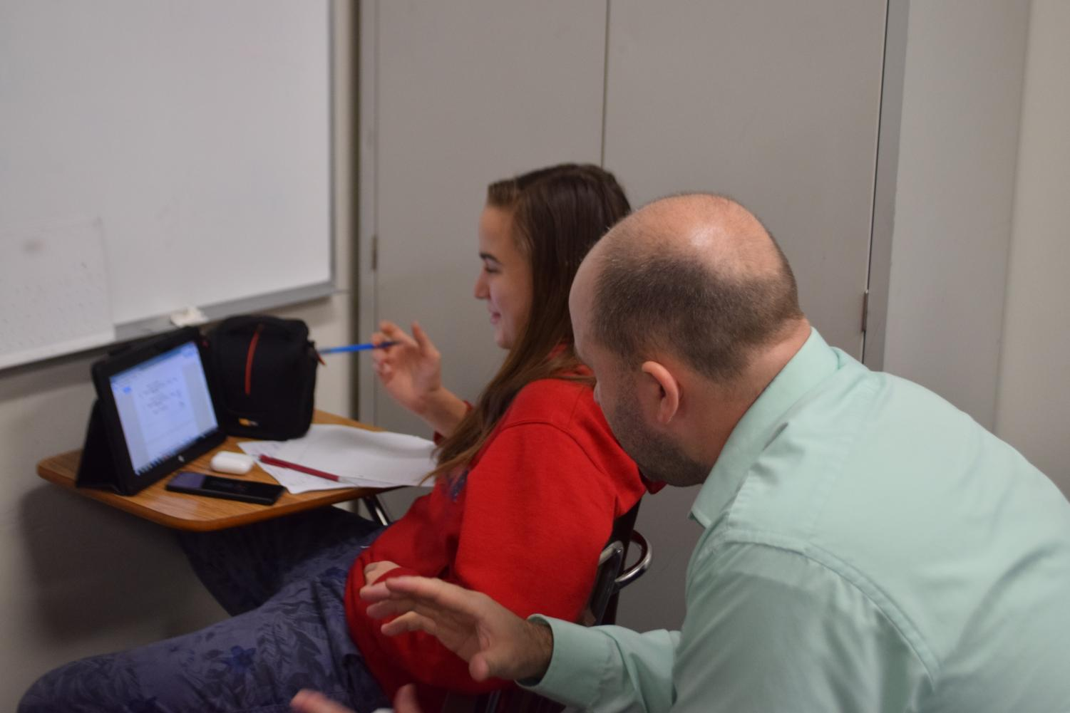 Algebra teacher Ricky Halteman helps Natalie Williams (9) in sixth hour Algebra lab. Photo taken by Gabby Abowitz.
