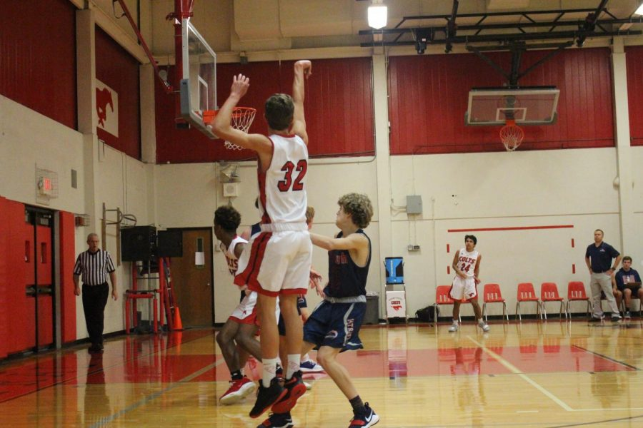 Sophomore Andrew Ahrens shoots against Parkway South, on November 26.
