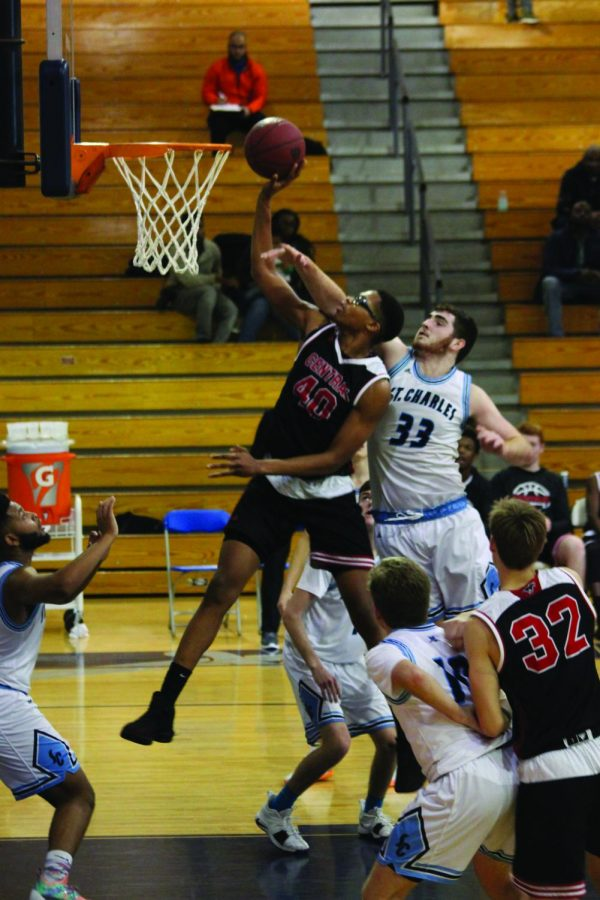 Junior center Devion Harris goes up for a shot against St.Charles West on Dec. 7.  The Colts won the game 51-38.