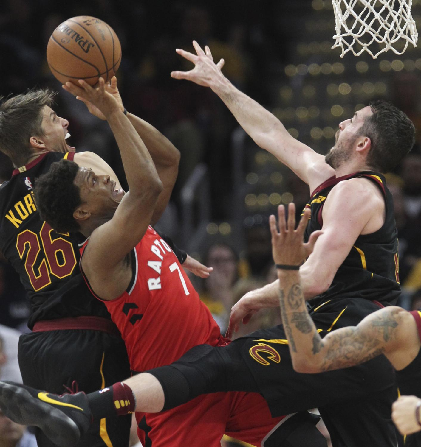 Toronto Raptors' Kyle Lowry is smothered inside during the first quarter by Cleveland Cavaliers' Kyle Korver (left) and Kevin Love in Game 4 of a second-round playoff series on Monday, May 7, 2018 in Cleveland, Ohio. (Phil Masturzo/Akron Beacon Journal/TNS)