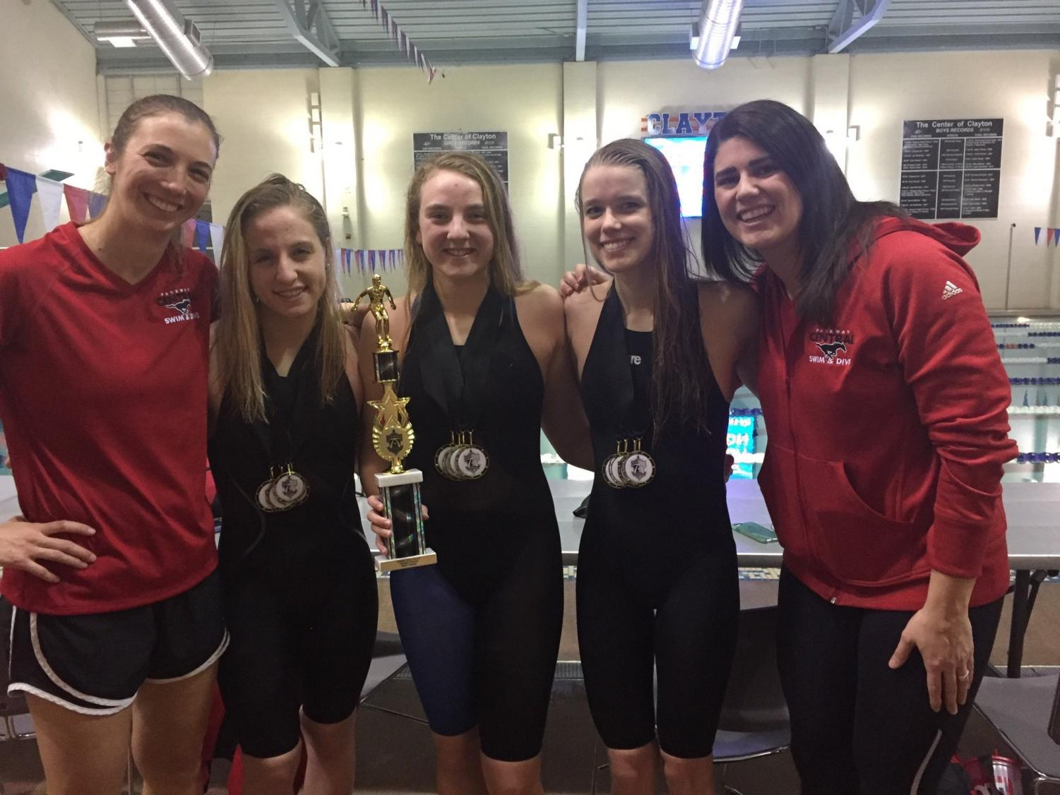 Former Head Coach Meyer and current Head Coach Seidel pose with former Parkway Central swimmers, Madison, Alexis Poe, and Annika Hofer. Photo courtesy of Jennifer Meyer