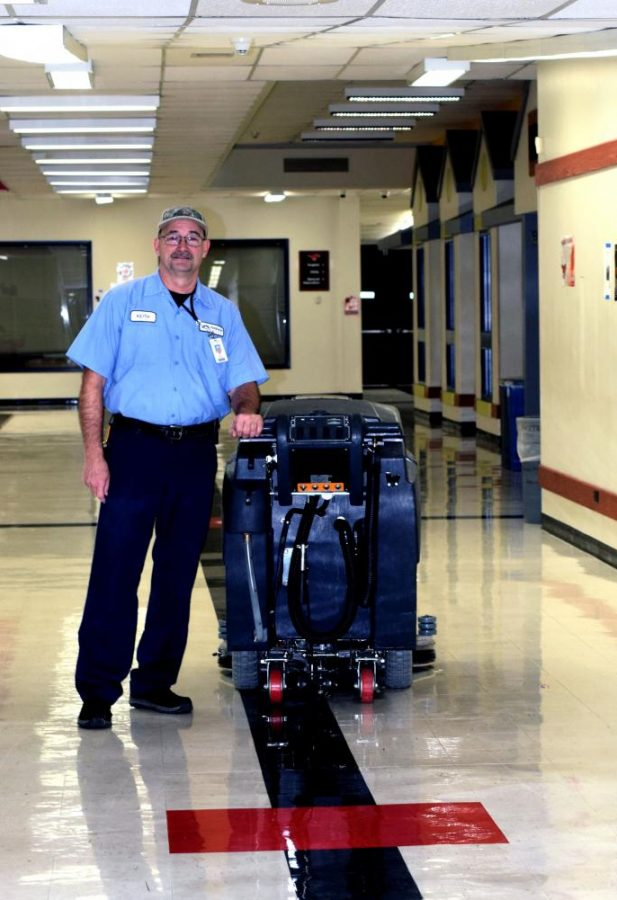 Parkway Central Custodian, Donald Keith Styles with a floor cleaner.