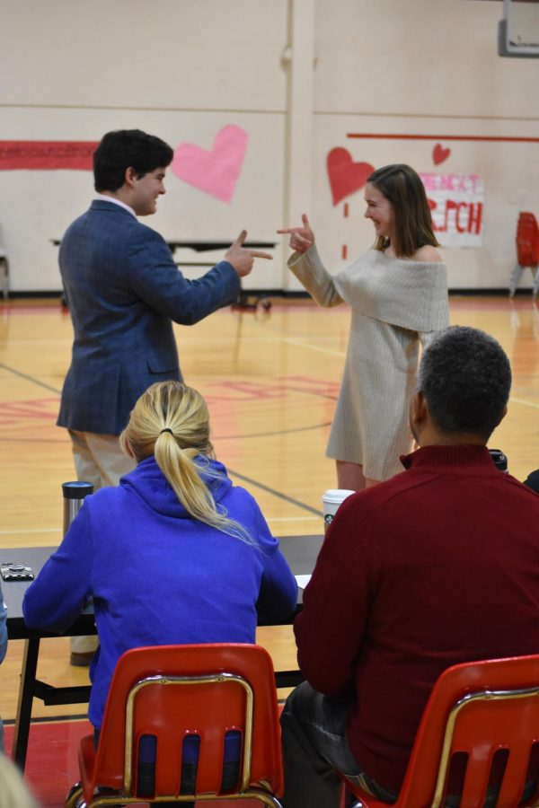 2018 Mr. PCH contestant Henry Eubank makes his entrance and does a handshake with then-senior Meghan Kane during the Mr. PCH Pageant.