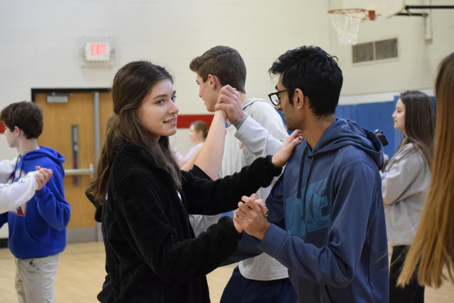 Sophomores Brooke Taeckens and Nikhil Deshmukh salsa dancing for a Spanish 3 activity.