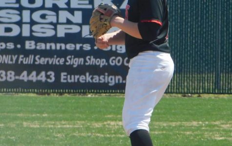 Current senior Sam Ladd takes his position at short stop in an away game at Eureka High.