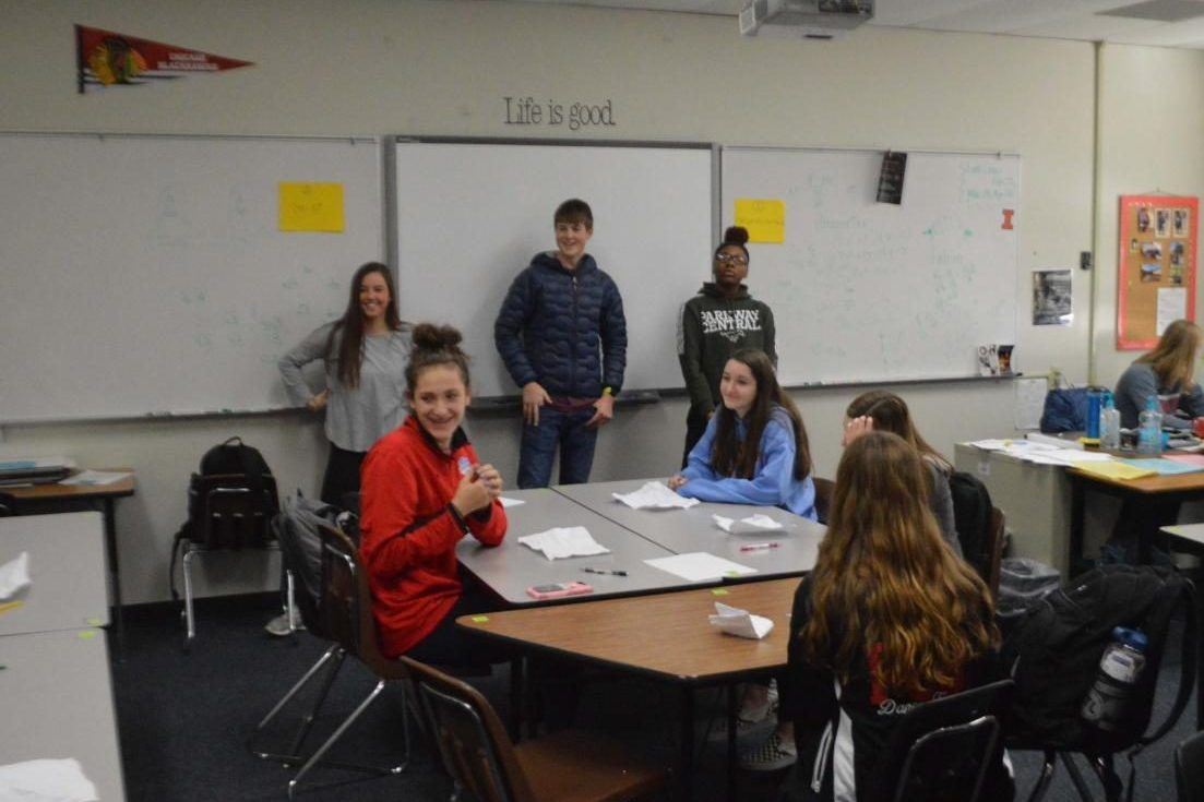 Link Leaders (background, left to right) Molly Wesolich (12), Jackson Sniff (11) and Makeeya Miller (12) help freshmen, such as (foreground, left to right) Jadyn Wallis (9) and Piper Douglas (9), deal with the things that cause them stress. The AC Lab played a game where everyone wrote a stressful thing on a piece of paper, crumpled it up, and threw them like snowballs. Each student then grabbed a random note and read it aloud to the class as the Link Leaders gave advice on how to deal with each issue.