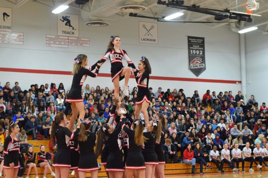 Fagan+O%27Connor+is+lifted+by+her+teammates+at+the+pep+rally+on+Feb.+9th.+