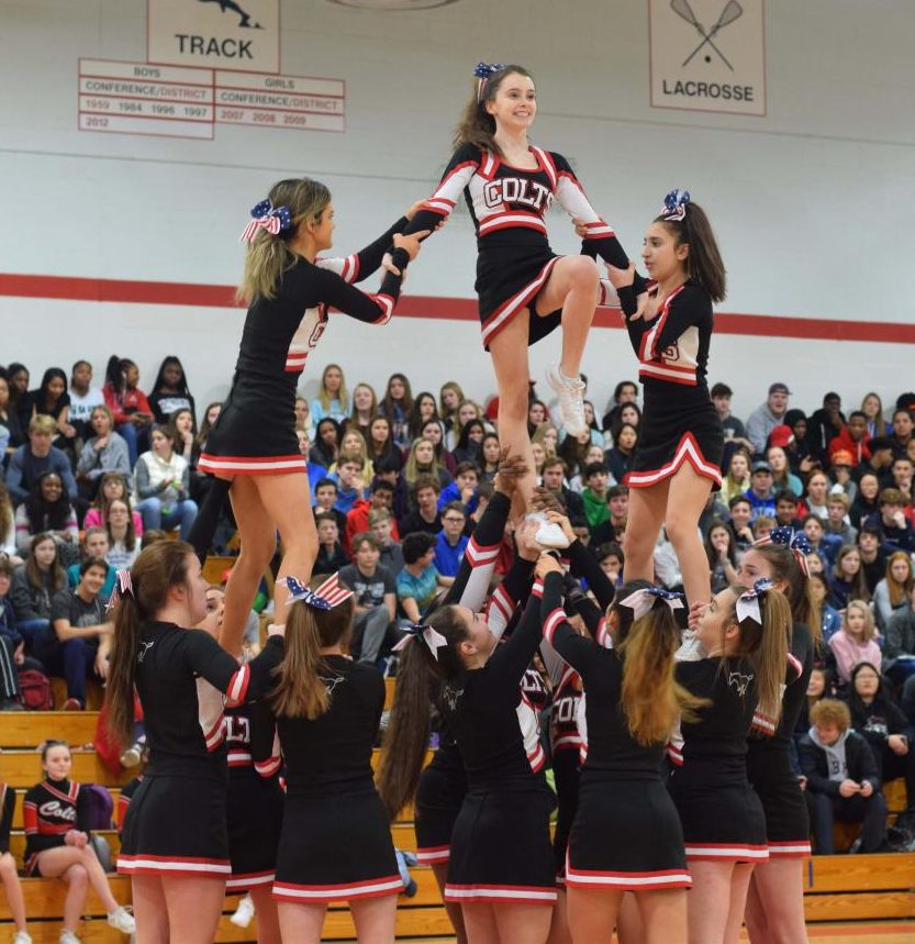 Fagan O'Connor is lifted by her teammates at the pep rally on Feb. 9th.