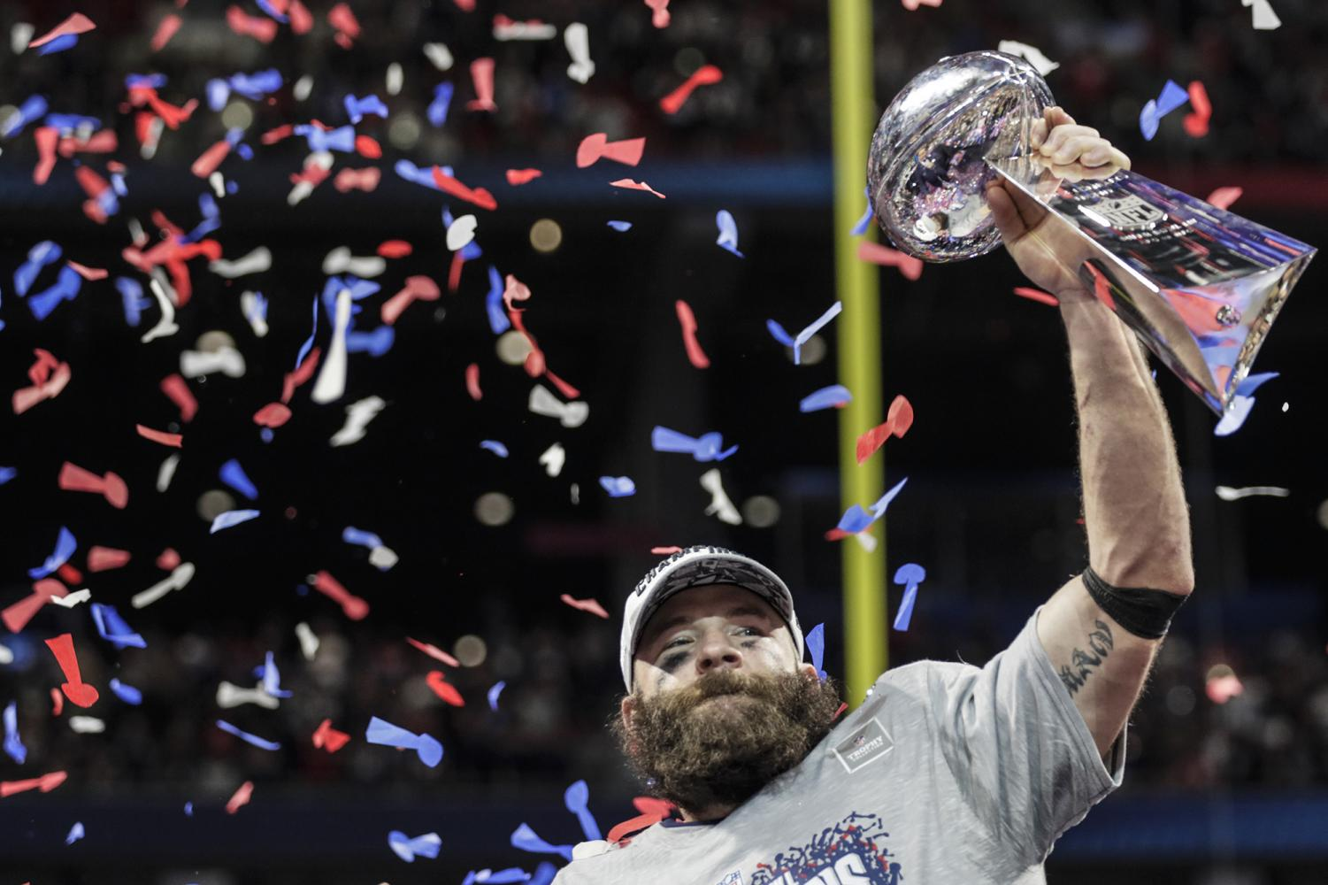 New England Patriots wide receiver Julian Edelman raises the Vince Lombardi Trophy after a 13-3 win against the Los Angeles Rams in Super Bowl LIII at Mercedes-Benz Stadium in Atlanta on Sunday, Feb. 3, 2019. (Curtis Compton/Atlanta Journal-Constitution/TNS)