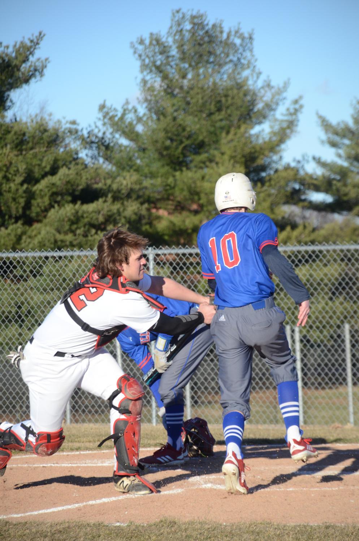 Sophomore Cal Reynolds tags Hillsboro's Brenden McLaughlin