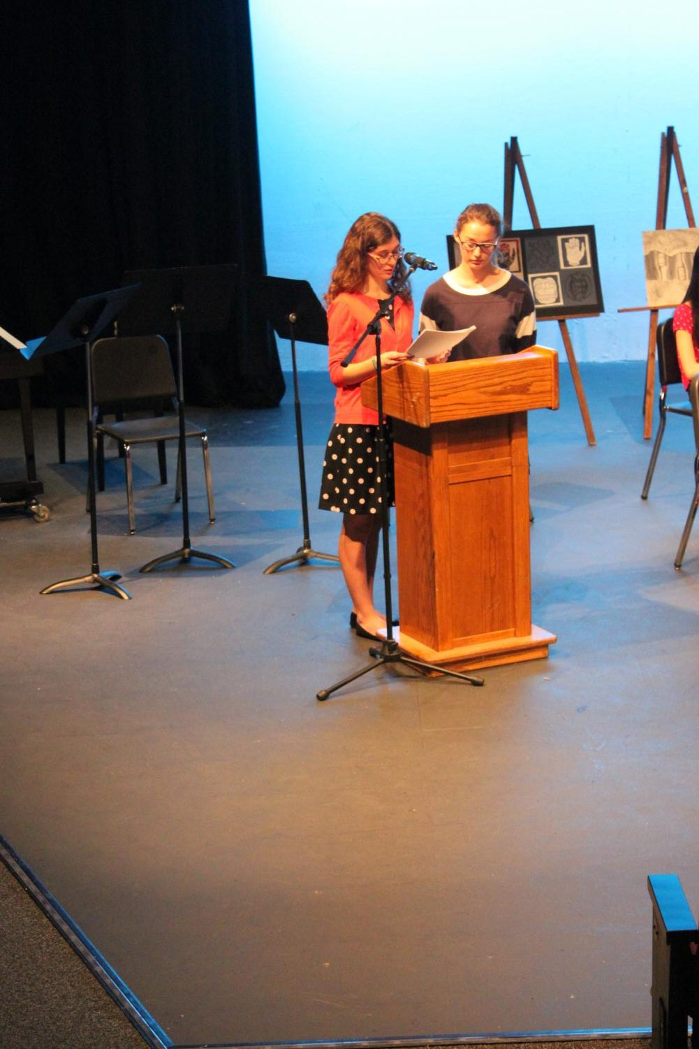 PCH Corral Editor-in-chief Athena Stamos and Copy Editor Maddie Lee announcing the inductees of the Quill and Scroll Honors Society at the Inductee ceremony.