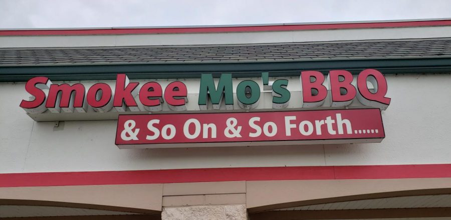 The sign for Smokee Mos with the tagline