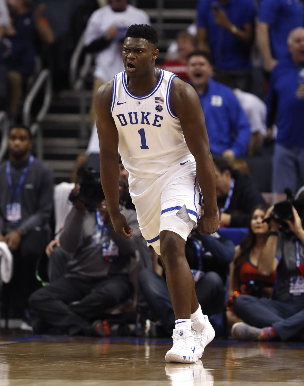 Duke's Zion Williamson (1) celebrates after slamming in two during the first half against Syracuse in the quarterfinals of the ACC Tournament at the Specturm Center in Charlotte, N.C., on Thursday, March 14, 2019. (Ethan Hyman/Raleigh News & Observer/TNS)