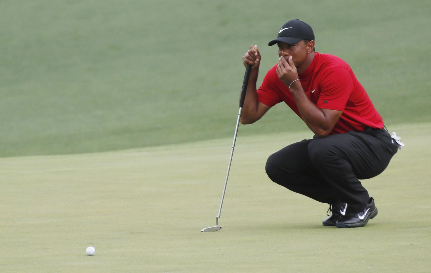 Tiger Woods lines up his putt on 2 during the final round of the Masters on Sunday, April 14, 2019, at Augusta National Golf Club in Augusta, Ga. (Bob Andres/Atlanta Journal-Constitution/TNS)