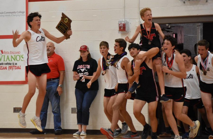 The boys cross country team takes center court during the parade of varsity athletes at the Homecoming Pep Rally on Friday, Sept. 13.