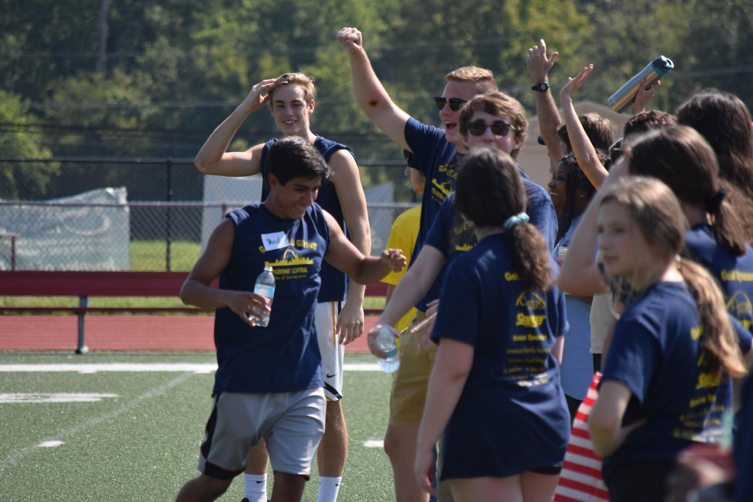 Dan Kelty's Ac Lab cheers on their team on the soccer fields as they play in the tournament.