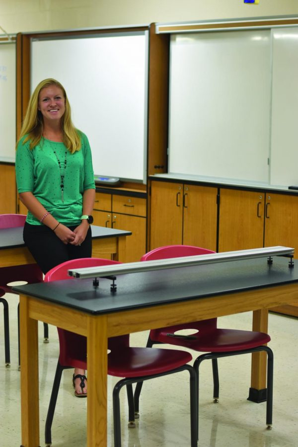 Hannah Merriman poses for a picture in her new science classroom