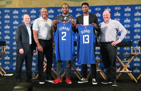 From left, Los Angeles Clippers President of Basketball Operations Lawrence Frank, head coach Doc Rivers, new players Paul George and Kawhi Leonard and owner Steve Balmer, at Green Meadows Recreation Center during a news conference in Los Angeles on Wednesday, July 24, 2019. (Wally Skalij/Los Angeles Times/TNS)
