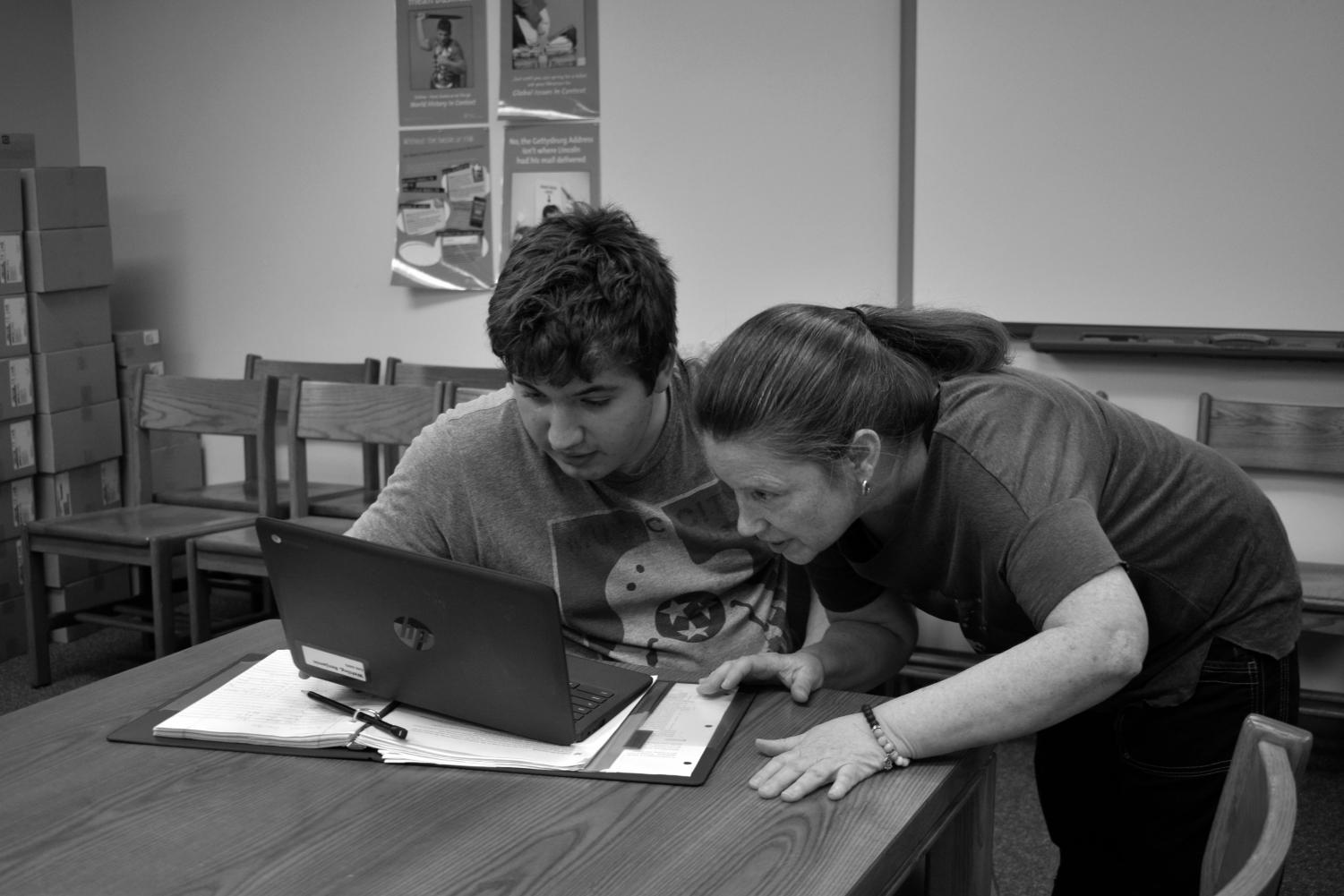 AP World Teacher, Dr. Susan King helps sophomore Benjamin Wehling in in her 6th Block AP World class. Photo by Kaylee Canoy.