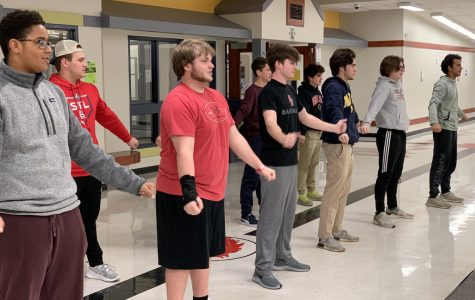 Junior and Senior Boys' Learning How to Cheer