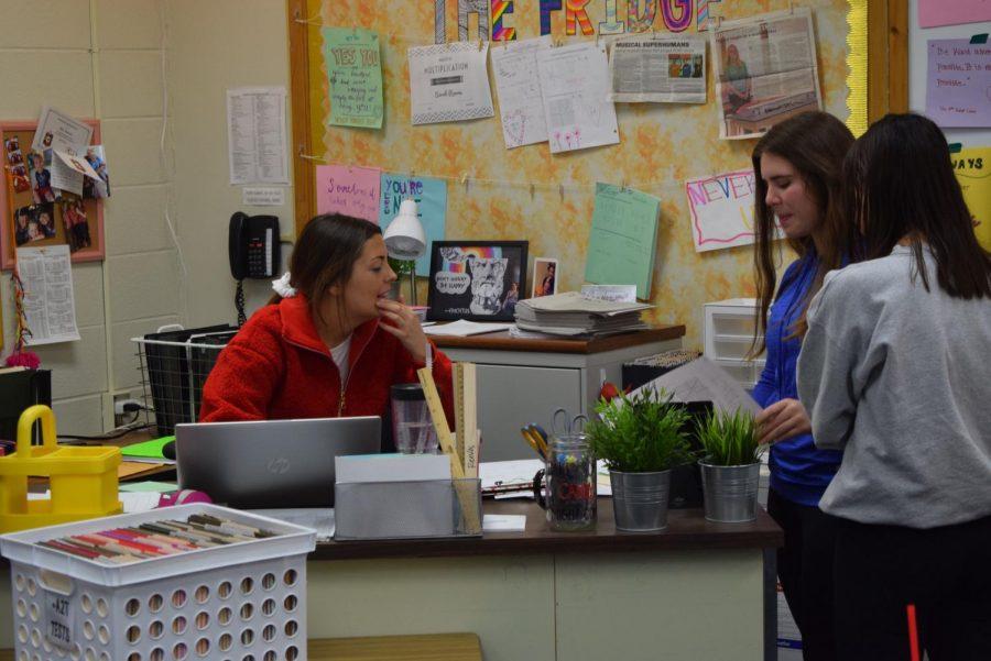 Math teacher Sarah Reeves helps sophomore Elisa Dohrmann with her work.