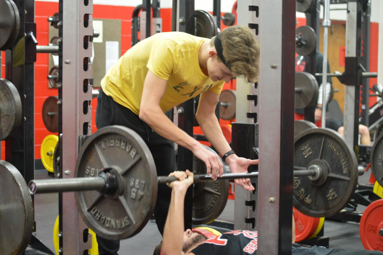 Matt Mendel (12) spotting Shamus Landry (12) in the weight room
