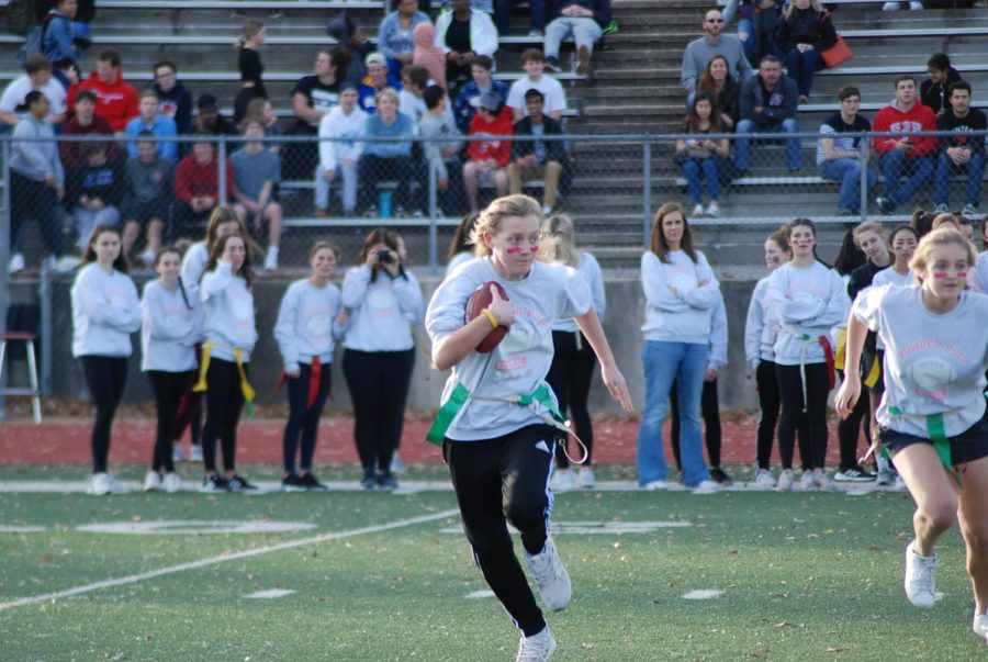 Junior Brooke Phelan running with the football avoiding the senior defendors.