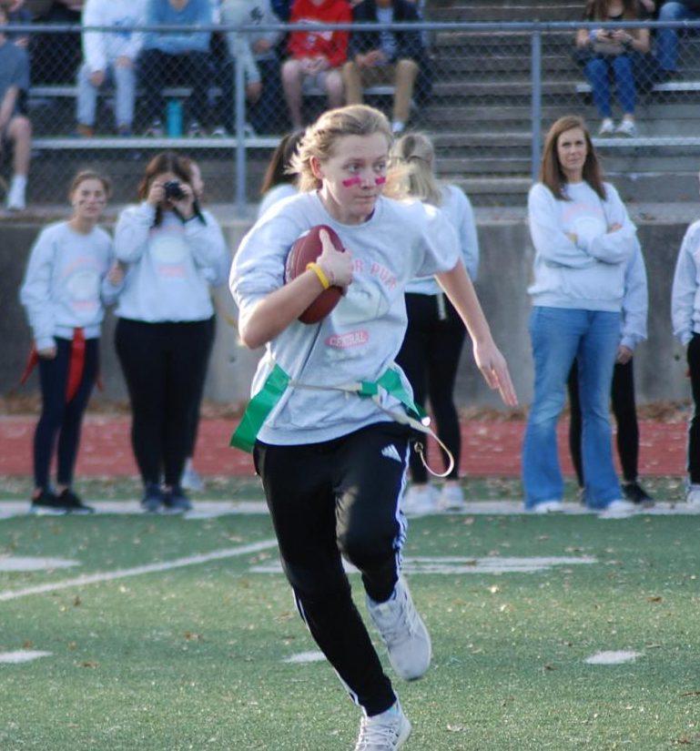 Junior Brooke Phelan running with the football avoiding the senior defendors.