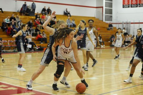 Senior Claudia Cooke posting up Parkway South defender. Girl