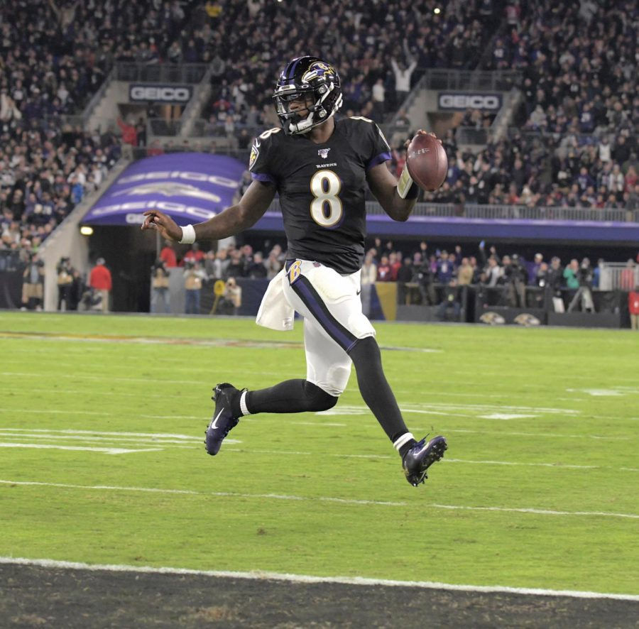 Baltimore Ravens quarterback Lamar Jackson saunters in for a touchdown against the New England Patriotsat M&T Bank Stadium in Baltimore on November 3, 2019. (Karl Merton Ferron/Baltimore Sun/TNS)