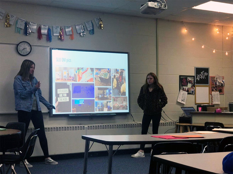 Executive directors juniors Sophie Sokolik and Sydney Kolker leading a weekly Dance Marathon meeting. They are going over a Dance Marathon event hosted by St. Louis University and what they want to bring to PCH from their event. Photo by Rebecca Barnholtz.