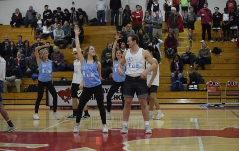 MacKenna Carpenter (12) and Anthony Klein (12) perform during half-time at the boys basketball game against Pattonville.