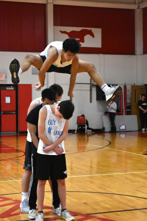 Nick Yn (12) jumps over other Mr. PCH contestants Jacob Stone, Adi Sarangee and Anthony Klein.