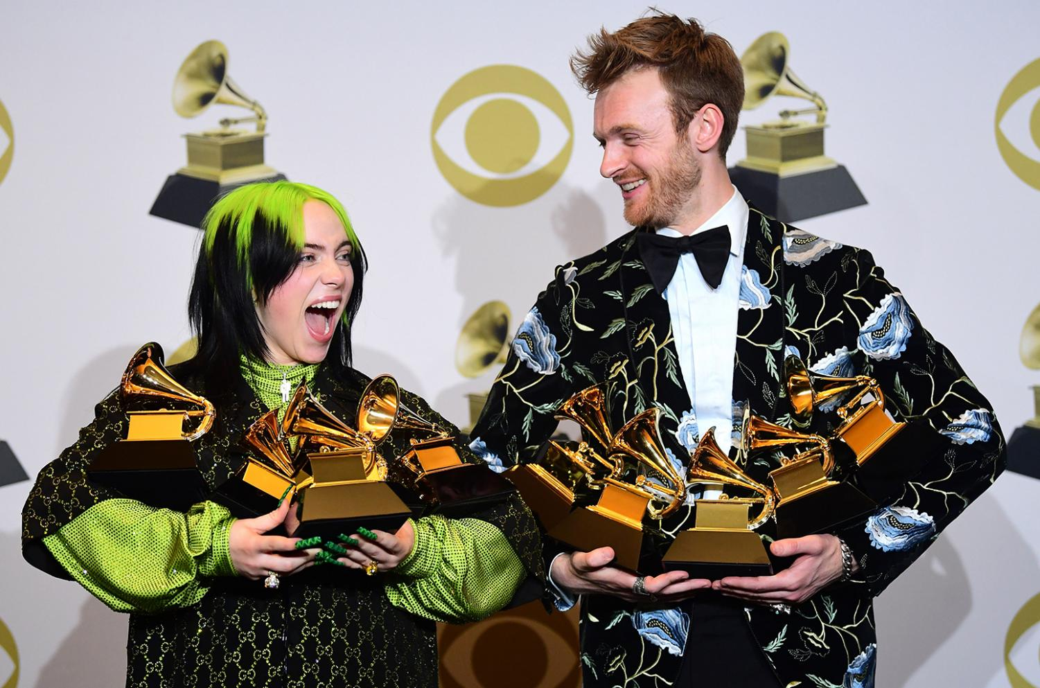 Billie Eilish and her brother and producer Finneas O'Connell holding the 10 total Grammys they won