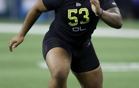 Offensive lineman Tristan Wirfs goes through his NFL draft combine workout. Wirfs was selected 13th overall by the Tampa Bay Buccaneers.